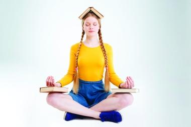 54403158 - female student meditating isolated on a white background
