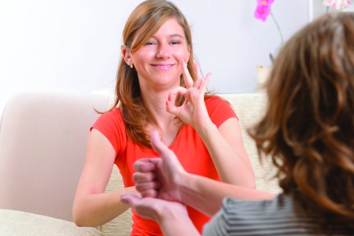 30142537 - smiling deaf woman learning sign language