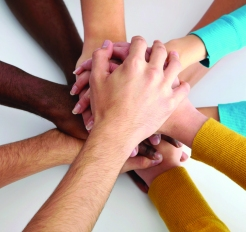 24849321 - high view of team of friends showing unity with their hands together