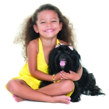 42299544 - cute small girl hugging her pet dog isolated on white
