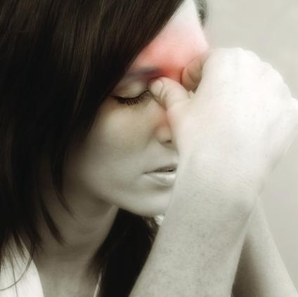 WomanHeadache_1450435Medium